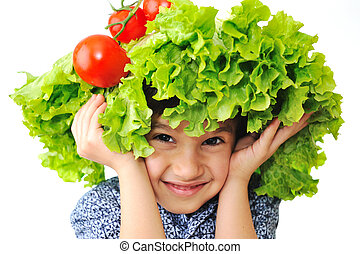 Kid with salad and tomato hat on his head, fake hair made of...