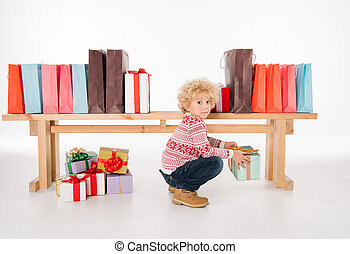 Kid with stack of gift boxes
