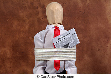 Kidnapped - Photo of a Mannequin Tied Up With a Newspaper