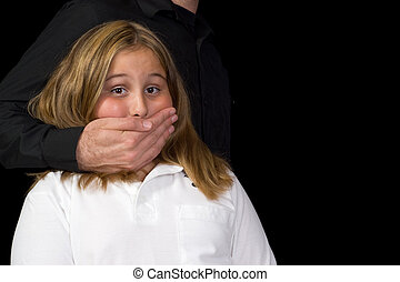 Kidnapping - A young girl standing scared with a hand...