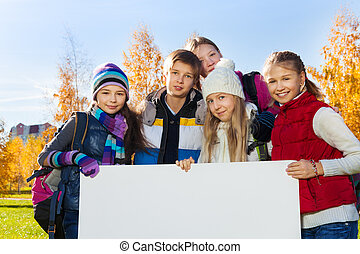 Kids and banner - Close portrait group of happy teen kids...