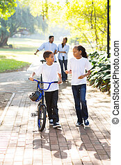 kids and parents walking at the park - kids and parents...