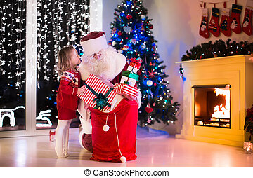 Kids and Santa opening Christmas presents