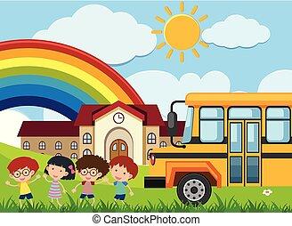 Kids and schoolbus in front of school