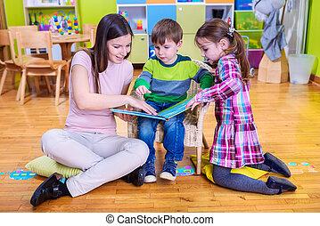 Kids And Teacher Reading Book