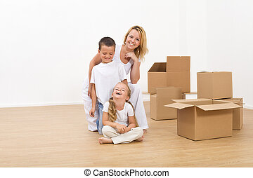 Kids and woman in their new big home