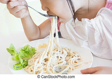 Kids are eating delicious spaghetti.