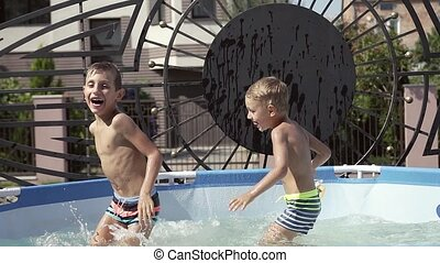 Kids are fun playing in the water and swim