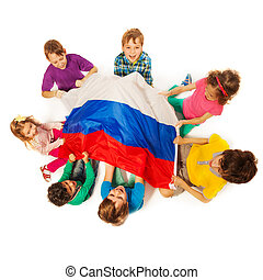 Kids around the flag of Russian Federation - Top view of...