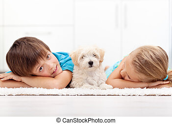 Kids at home with their new pet