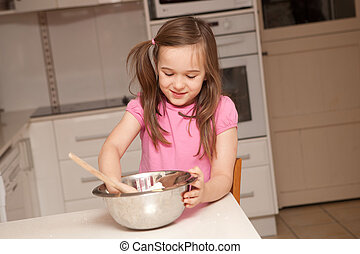 Kids baking muffins in a kitchen