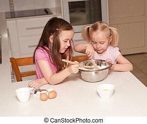 Kids baking muffins in a kitchen