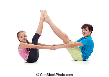 Kids balancing together sitting on the floor