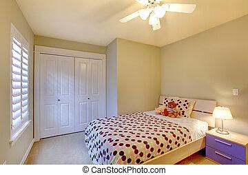 Kids bedroom with minimal design and beige walls.
