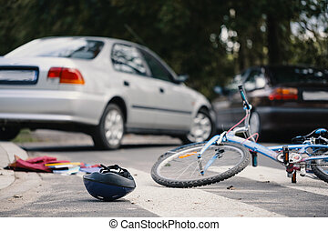 Kid's bike and helmet on pedestrian crossing after collision with drunk car driver