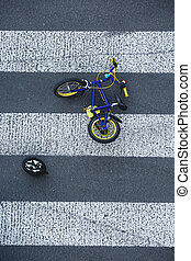 Kid's bike lying on the road after car accident