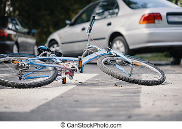Kid's bike on a pedestrian lines after danger incident with a car