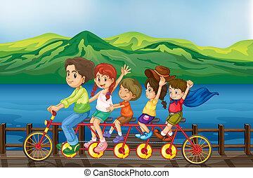 Kids biking at the bridge