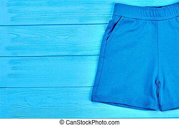 Kids blue textile summer shorts.