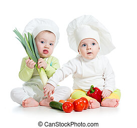 kids boy and girl wearing a chef hat with healthy  food vegetables