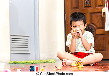 kids boy with play clay toys at home