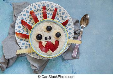 Kids breakfast oatmeal porridge with fruits