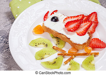 Kid's breakfast toast with fruit and cream cheese