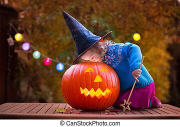 Kids carving pumpkin at Halloween - Little girl and boy...