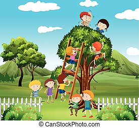 Kids climbing up tree in the park