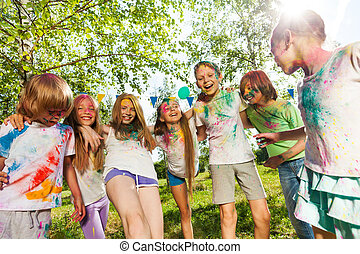 Kids colored with color powder dancing  outdoor