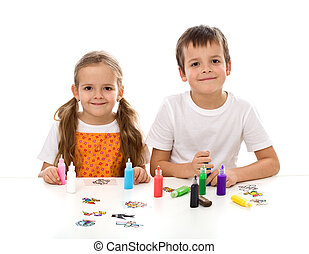 Kids coloring with lots of small painting bottles