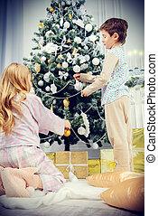 kids decorate a tree