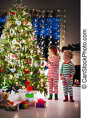 Kids decorating Christmas tree - Happy little kids in...