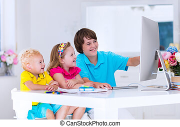 Kids doing homework with modern computer