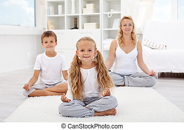 Kids doing yoga relaxing exercise