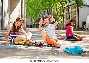 Kids draw with chalk child shows palms
