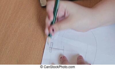 Kids drawing at kindergarten by pencils