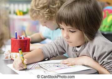 Kids Drawing at Kindergarten - Two kids drawing at...