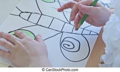 Kids drawing at kindergarten by felt pen