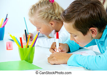 Kids drawing - Portrait of cute boy drawing with colorful...