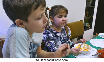 kids eat - boy at the table eating meat chop holiday with...