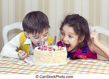 Kids eat cake Kids have fun eating birthday cake stock images