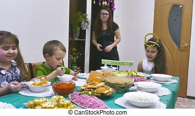 kids eat - Children eat family breakfast boy and girl...