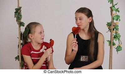 Kids eating lollipop