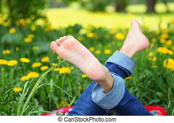 kids feet on the sunny meadow