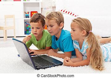 Kids found something interesting on laptop computer studying...