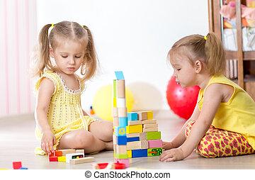 Kids girls playing at home