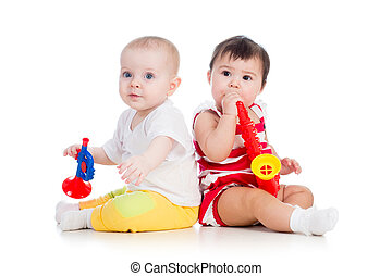 kids girls playing with musical toy