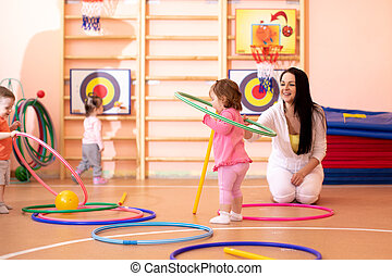 Kids group with colorful hula hoops