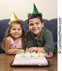 Kids having birthday party. - Hispanic girl and boy wearing ...